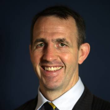 Smiling headshot of Consultant Urological Surgeon, Mr Ben Challacombe