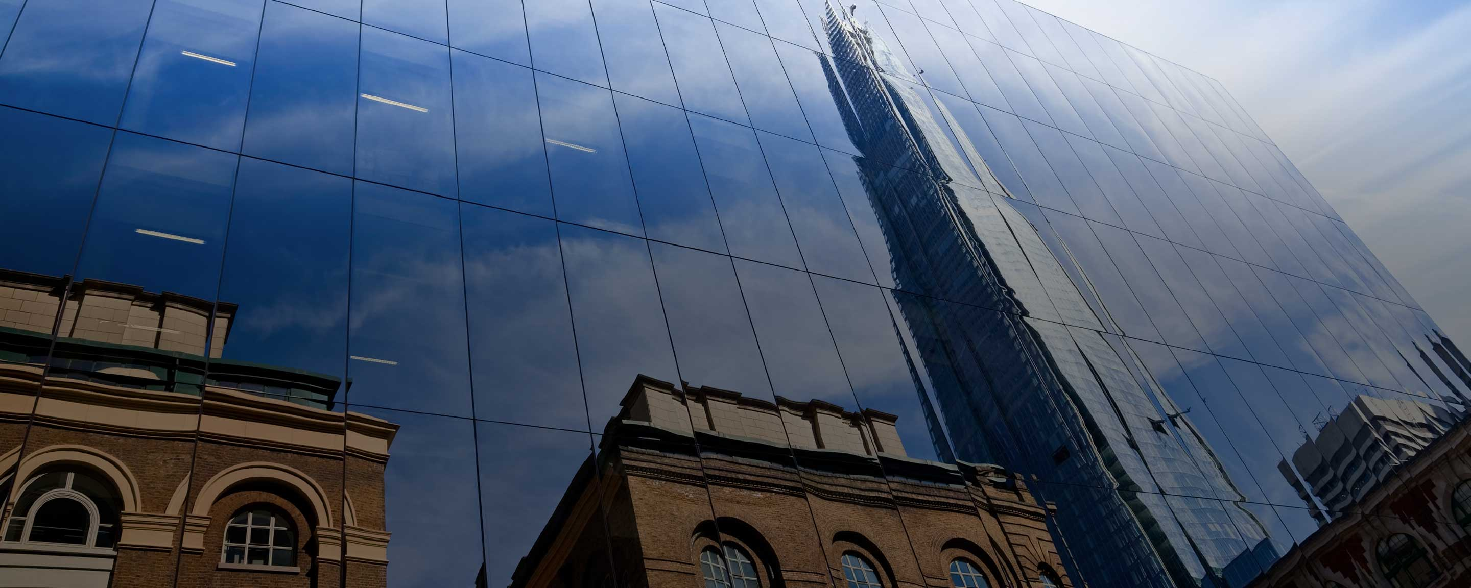 View of The Shard in building reflection