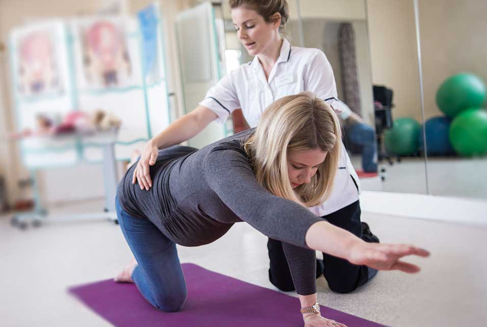 Pregnant patient having antenatal physiotherapy