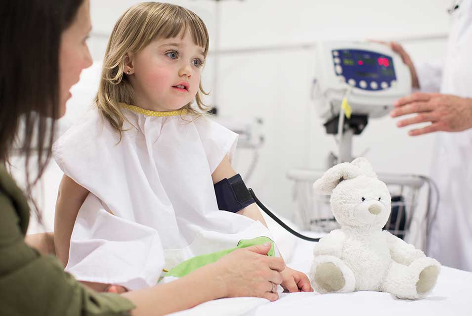 Child patient in having blood pressure taken