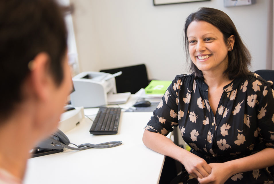 GP smiling at patient