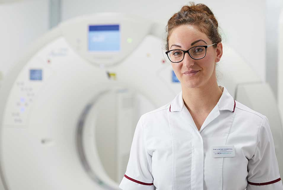 Nurse in front of CT scanner